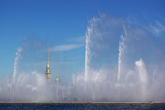Fountain on Neva river. And St.Pier cathedral gold needle. S. Petersburg, Russia Royalty Free Stock Photos