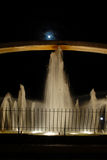 Fountain at night. With blue moon in the background royalty free stock images