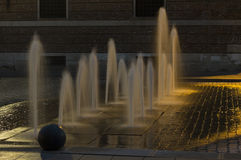 Fountain in the night. A fountain in the night enlightened by the streetlights Stock Photos