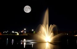 Fountain at night with full moon Stock Photography