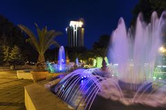 Fountain and night light in the town-hall park Royalty Free Stock Photography