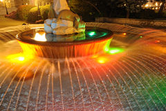 Fountain night lighting Stock Images