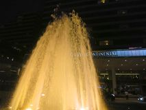Fountain at night lit up at InterContinental Hotel in Hong Kong Stock Image