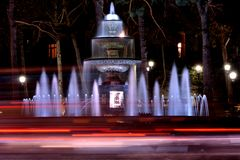 Fountain at night in park in Baku, capital of Azerbaijan. A night scene showing water in a fountain and light trails from cars travelling in Azerbaijan Royalty Free Stock Photos