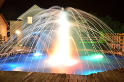 Fountain at night. Shot in a recreation area in the Republic of Altai Chemalsky Russia Stock Photo