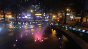 Fountain in the night - timelapse. Turtle fountain in the District 1 in center of the Ho Chi Minh city during the night stock footage