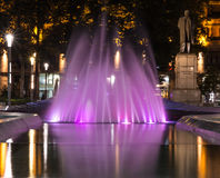Fountain at Nikola Pasic square in Belgrade, Serbia,. Beautiful pink fountain at Nikola Pasic Square in Belgrade, long exposure photography, monument of Nikola Stock Photography