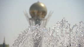 Fountain in Nur-Sultan, capital of Kazakhstan. Baiterek Tower the symbol of Nur-Sultan, capital of Kazakhstan with fountain foreground, slow motion stock footage