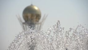 Fountain in Nur-Sultan, capital of Kazakhstan. Baiterek Tower the symbol of Nur-Sultan, capital of Kazakhstan with fountain foreground, slow motion stock video footage