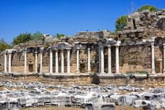 Fountain of Nymphaeus in Side, Turkey. Beautiful ruins of a great structure against the blue sky. Royalty Free Stock Photo