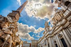 Free Fountain Of Rivers In Rome In Italy. In The Background, The Baroque Church Of Santa Agnese In Agone Stock Images - 184180334
