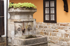 Fountain of old rural house Stock Image