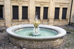 Fountain in old town street Stock Photos