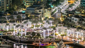 Fountain and palms timelapse at the Marina walk, During night time. Dubai, UAE stock video footage
