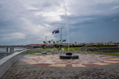Fountain in Panama City with country flag and Casco Viejo Old City on background - Panama City, Panama Royalty Free Stock Photos