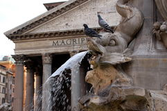 Fountain and Pantheon - Rome. Roman temple later consecrated as a Catholic Church. Fountain in front of the Pantheon, Also known as Chiesa di Santa Maria and Royalty Free Stock Image