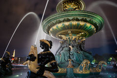 Fountain in Paris. With city behind, night photography Royalty Free Stock Images