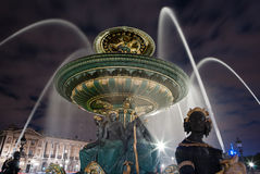 Fountain in Paris. With city behind, night photography Stock Images