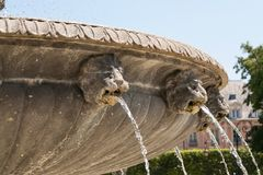Fountain, Paris, France. A closeup of the lions heads on a fountain in Place des Vosges, Paris Stock Photography