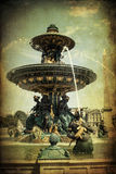 Fountain in Paris with vintage style texture Royalty Free Stock Photo