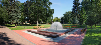 Fountain in park. And green grass Royalty Free Stock Photography
