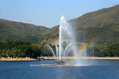 Fountain in a park with rainbow Stock Photography