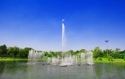 Fountain at the park. Fountain in the park rising. With a sky blue background Stock Image