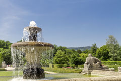 Fountain in the park of roses. Stock Photos