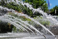 Fountain in the park, water jets in a row. `Planten un Blomen` city garden in Hamburg, Germany royalty free stock image