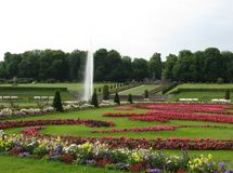 A fountain in the parkland of a palace Stock Images