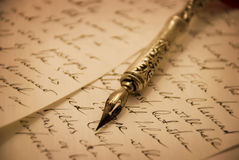 Fountain pen. Lying on a piece of paper Royalty Free Stock Images
