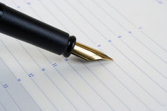 Fountain Pen. Gold Note Pad calendar Page Royalty Free Stock Images
