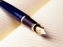 Fountain pen. On a blank page open on a diary book royalty free stock photography