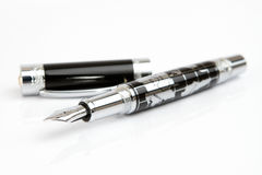 Fountain pen. With world map on it stock photography