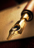 Fountain Pen. Antique fountain pen close-up on old paper Royalty Free Stock Photo