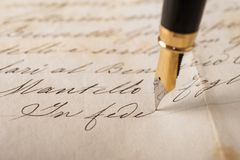 Fountain pen. Writing on an old handwritten letter stock images