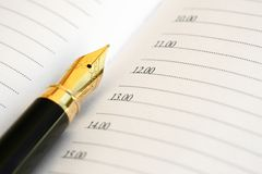 Fountain pen. On personal organiser, close up royalty free stock photos