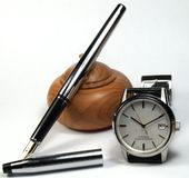 Fountain pen. And classic watch over white background stock photo
