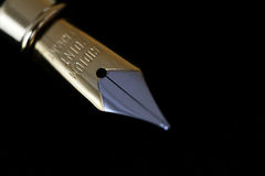 Fountain pen. Close up of a fountain pen on a black background Stock Images