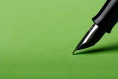 Fountain pen. Macro isolated fountain pen on green background Stock Photo