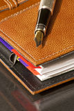 Fountain pen on agenda Stock Image