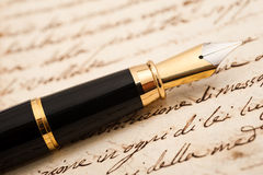 Fountain pen. On an antique handwritten letter stock image