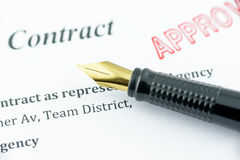 Fountain pen on an approved contract. Stock Image