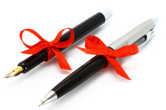 Fountain pen and ball pen with red bow Royalty Free Stock Image