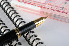 Fountain pen, bills and document Stock Images