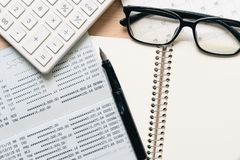 A Fountain pen and Black eye glasses spectacles is placed on a c stock photography