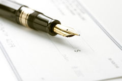 Fountain Pen on Blank Check Royalty Free Stock Image
