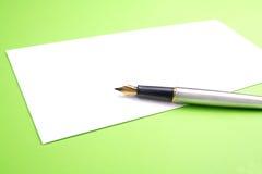 Fountain pen on blank letter Stock Photos