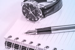 Fountain pen on blank notepad Royalty Free Stock Image