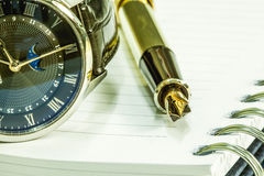 Fountain pen on blank notepad and watch Stock Photography